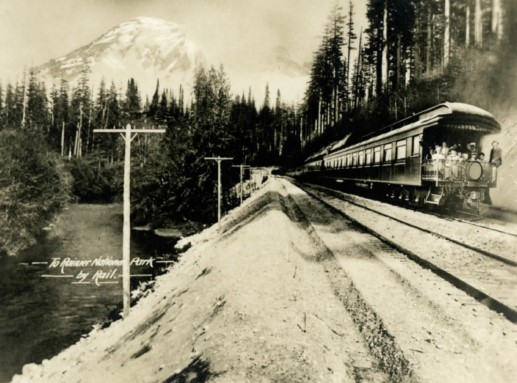 Photo of a train with Mt. Rainier in background.