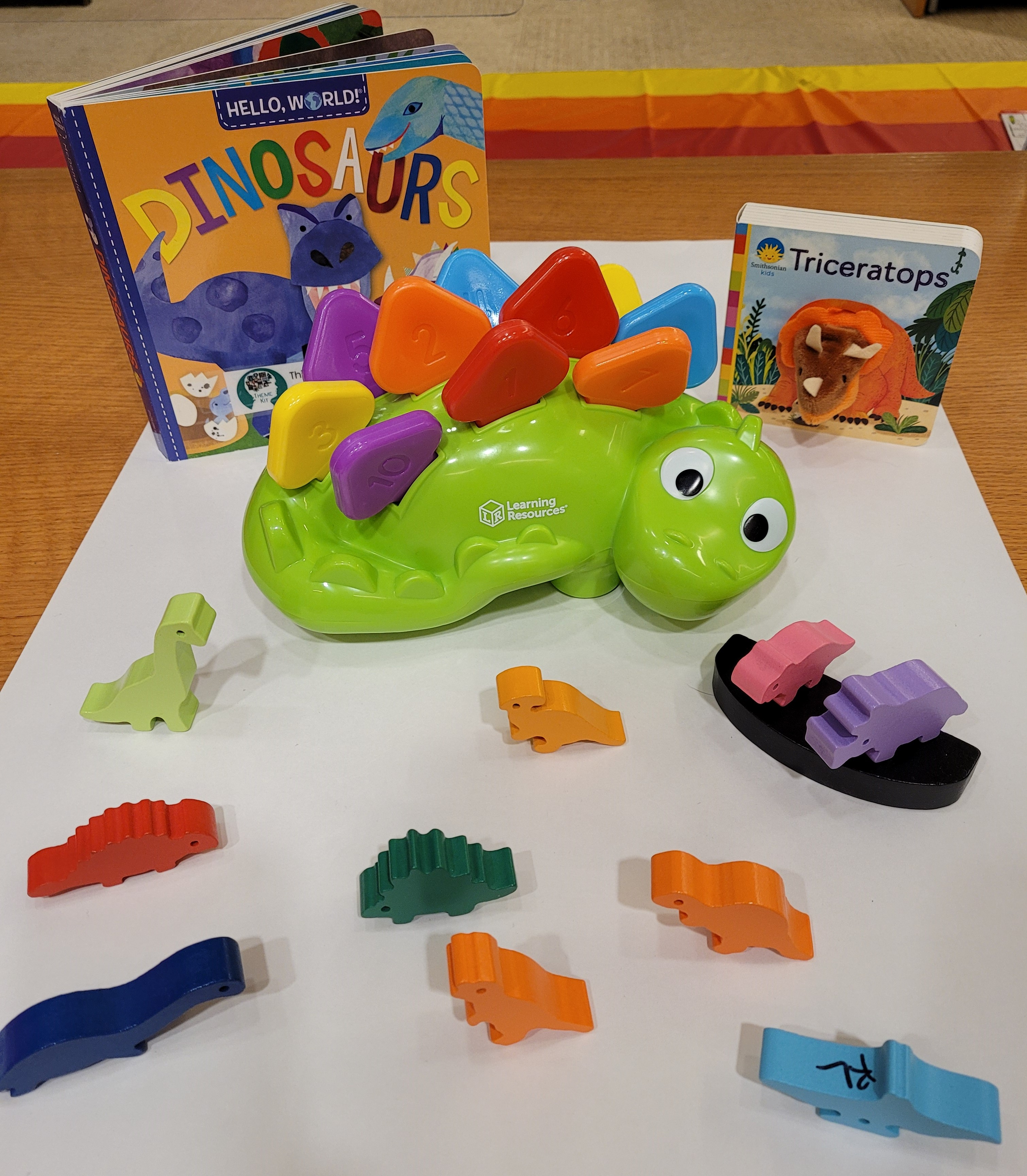 Steggy the dinosaur puzzle and wooden dinosaur balancing game