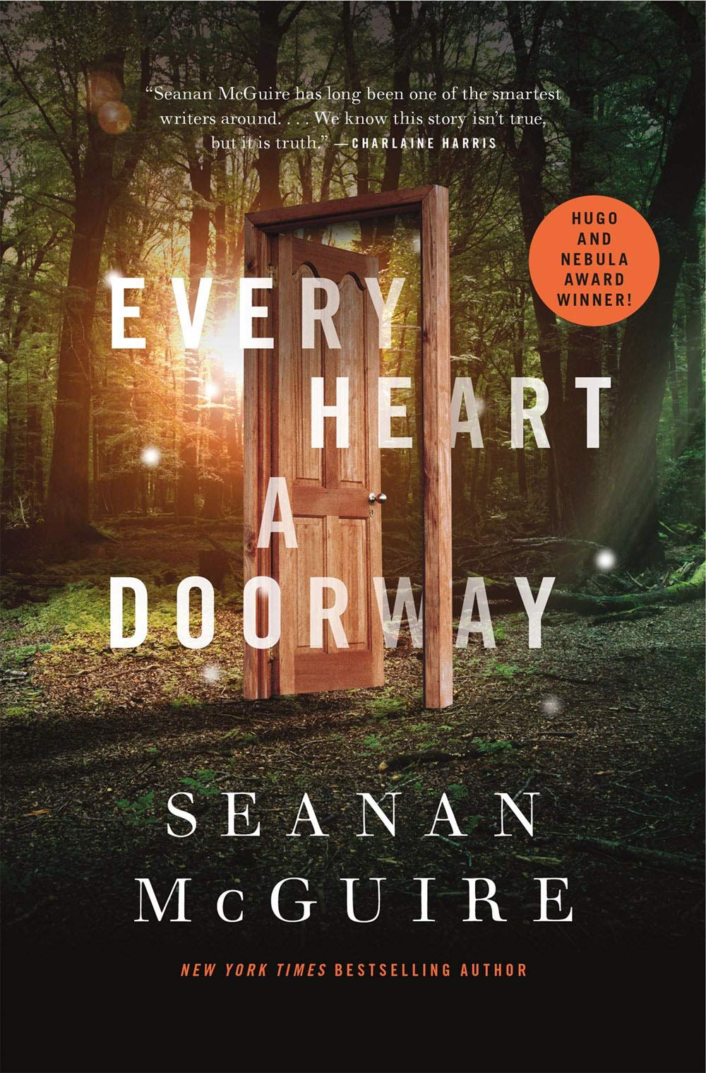 The cover of Every Heart a Doorway. It shows a door in the middle of a forest. There is a yellow glow behind it.