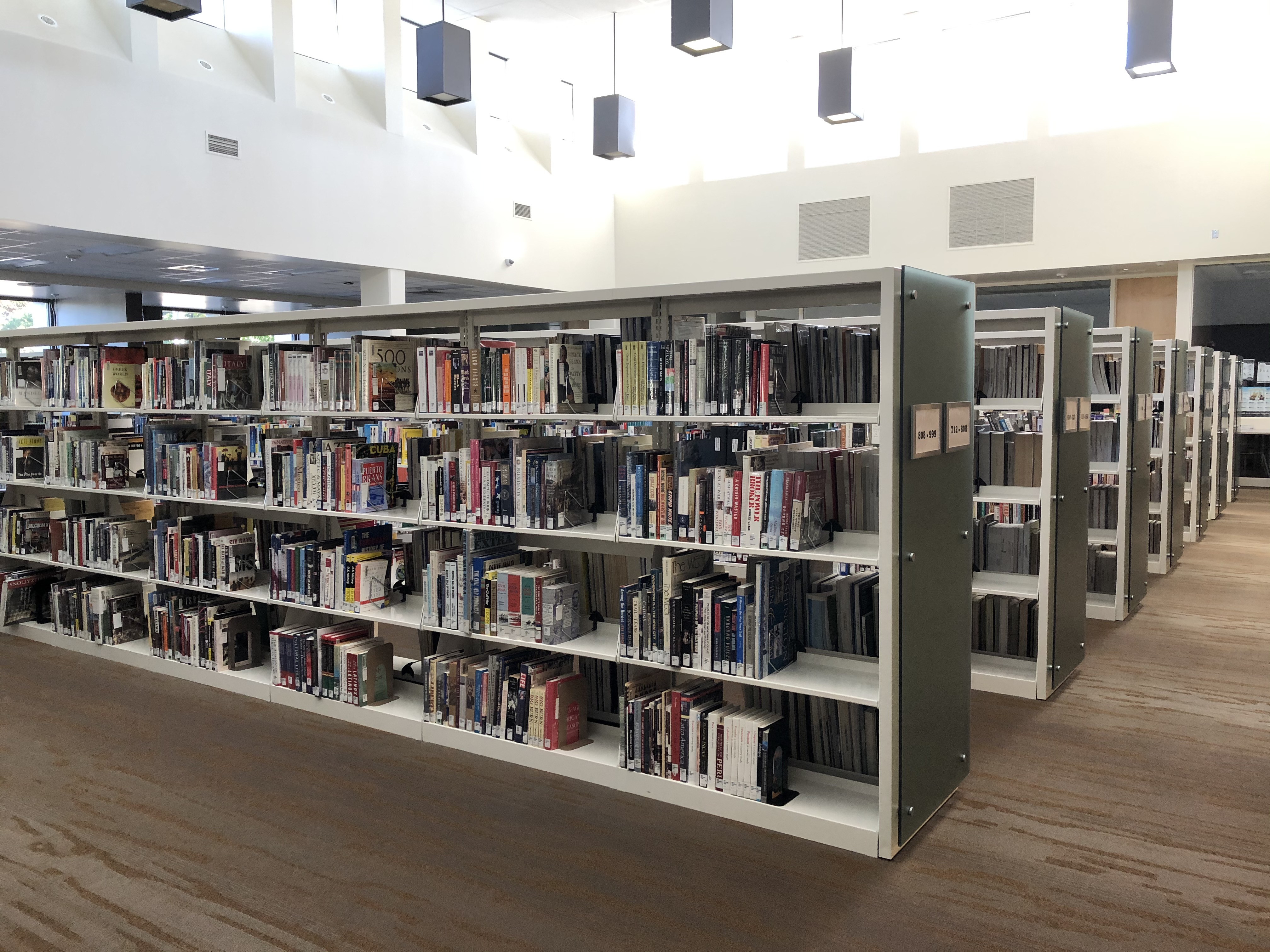 rows of bookshelves in library