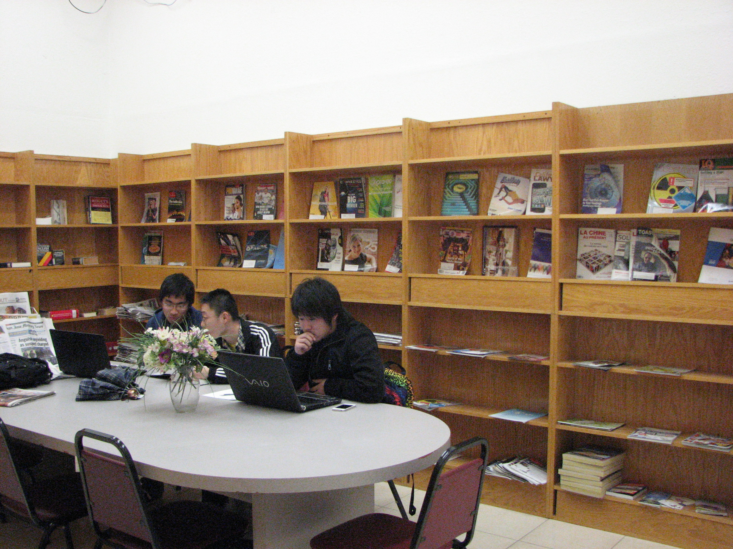 A group students are reading in the library