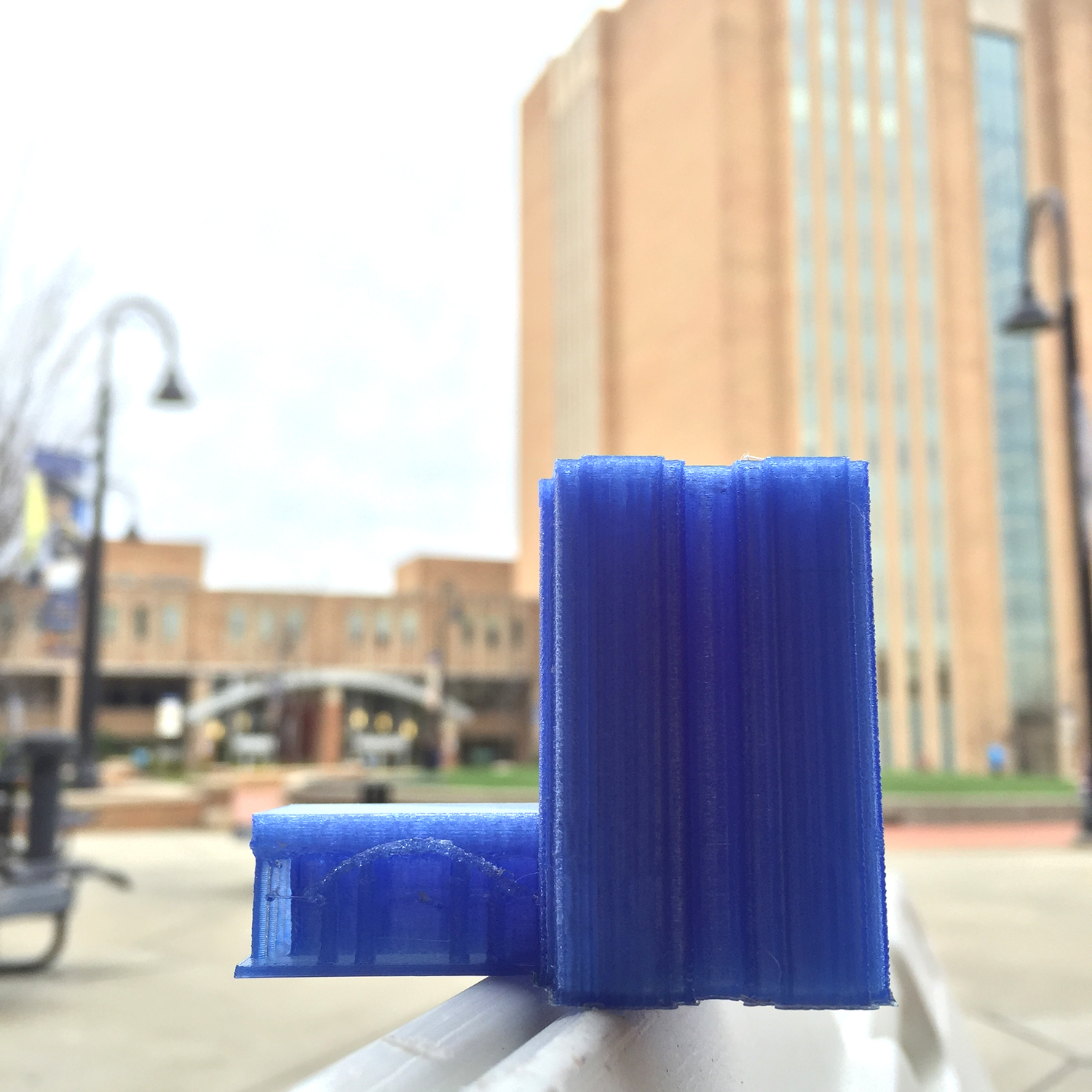 a 3D printed version of the Kent State University Library is on display in front of the building itself