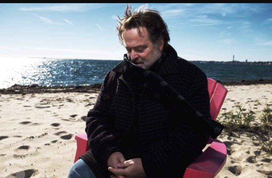 Photo of Michael Klein sitting on the beach