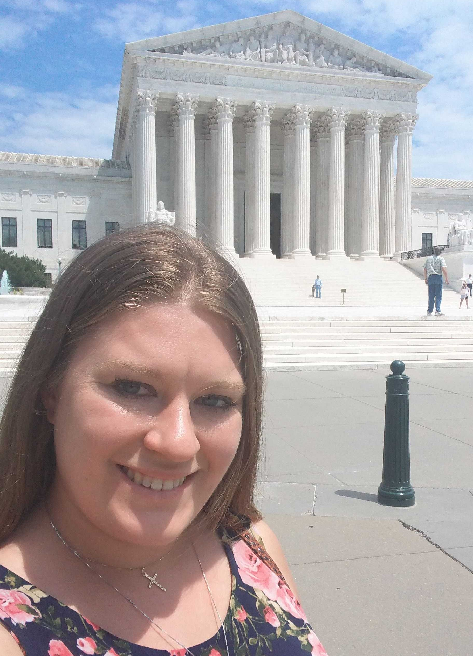 Julianne Odin stands in front of the Supreme Court Building.