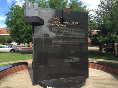 "A black stone monument reading: ""1921 Black Wall Street Memorial"""