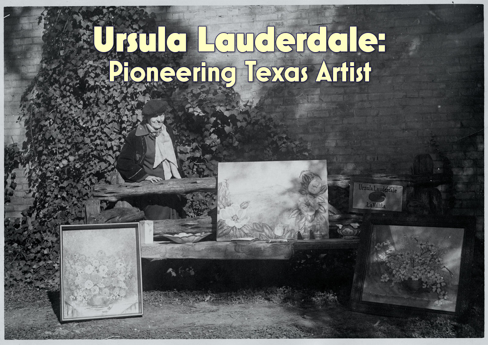 Image of Ursula Lauderdale posing outdoors with some of her paintings.