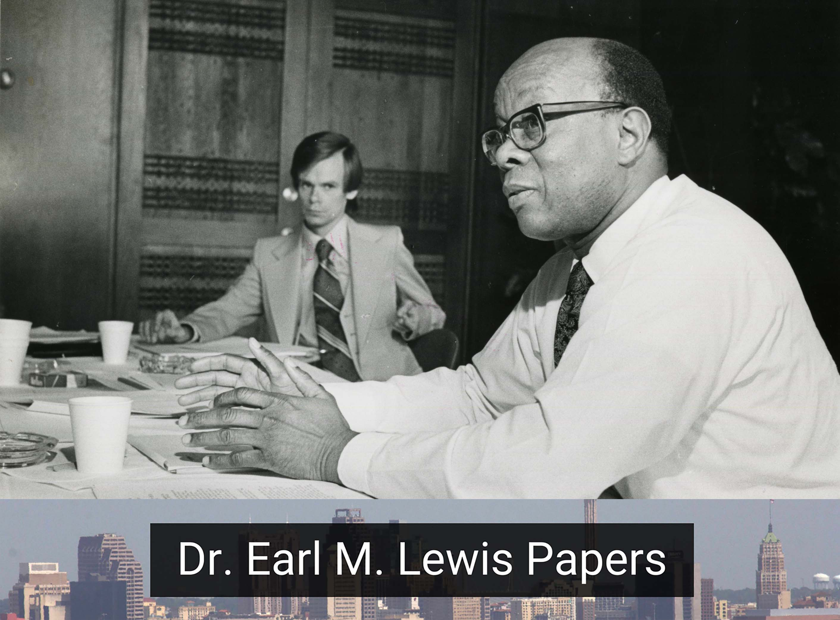 Image of Dr. Ear M. Lewis sitting at a table during an Urban Studies Seminar