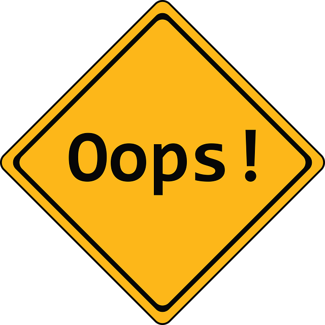"Yellow sign showing the word ""oops"""