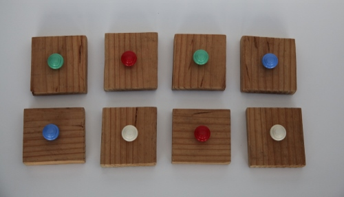 Wooden clapping blocks with coloured handles
