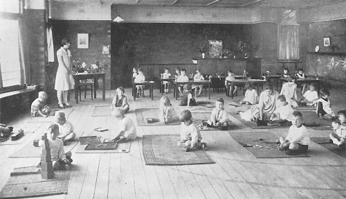 Children on mats playing at Keith Sheridan Kindy