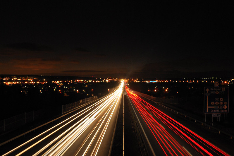 Highway at nighttime with traffic lights