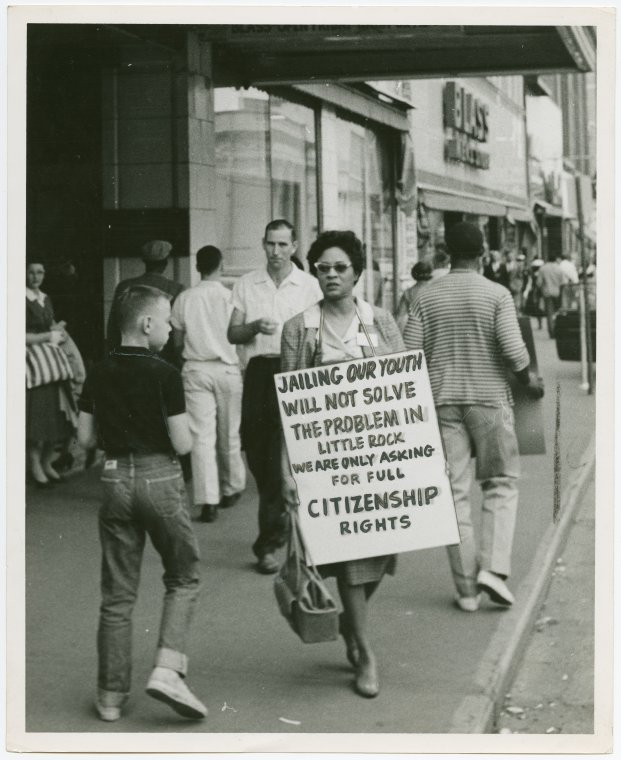 Activist Daisy Bates picketing with a placard: