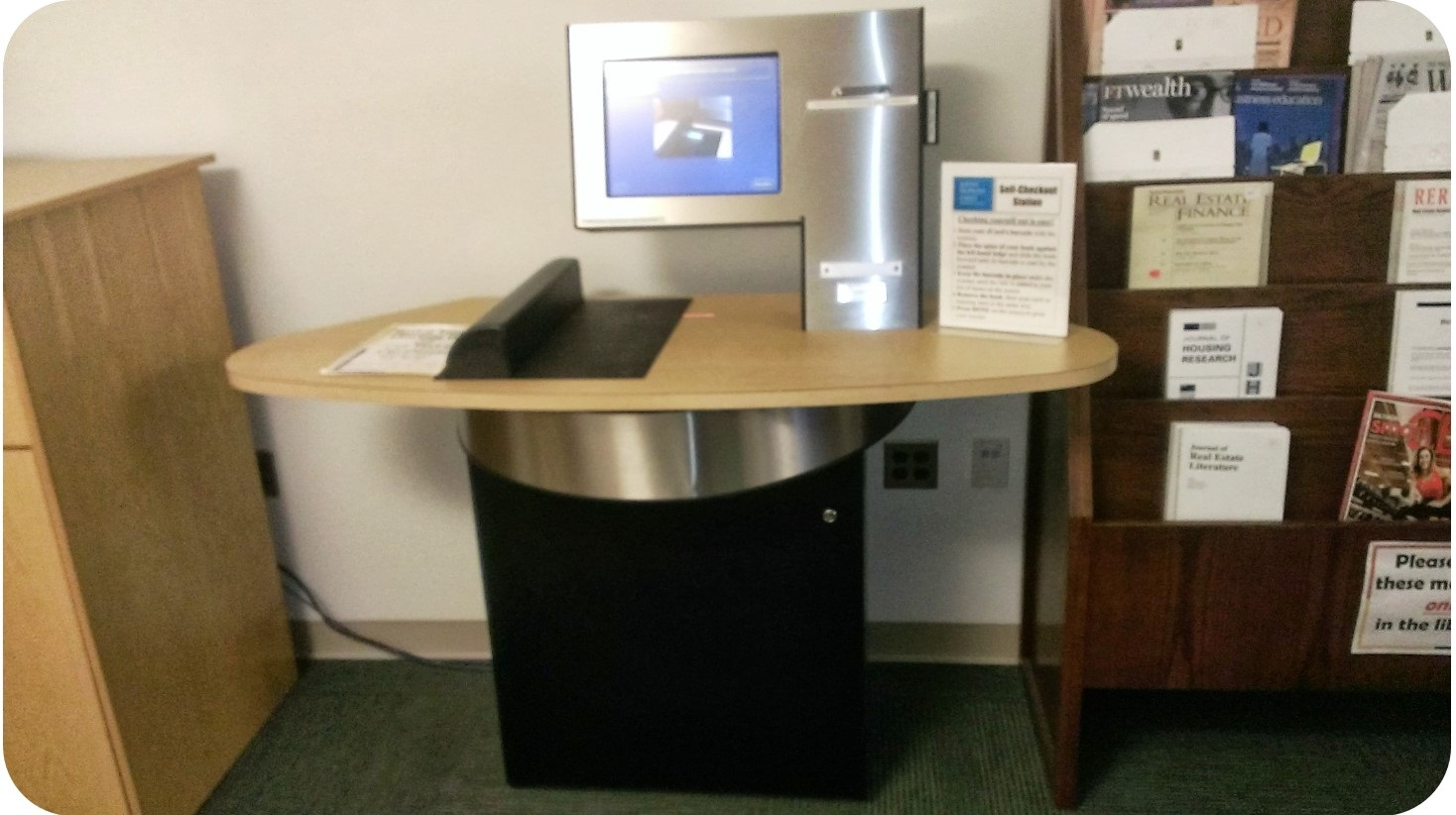 4. This is the self-checkout unit at the Harbor East Library.  It's just inside the main library door, on the left