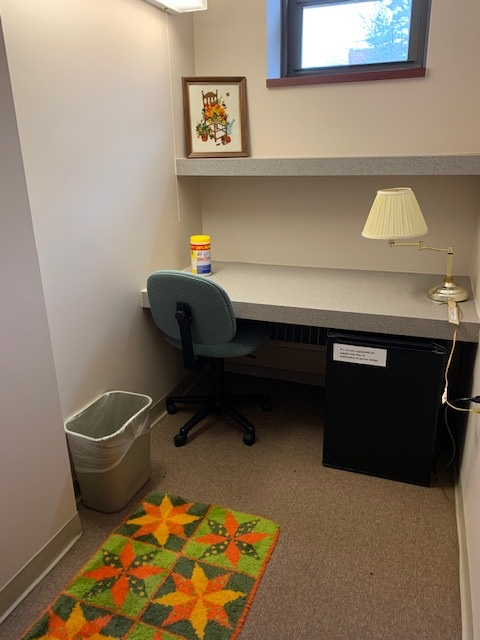 Lactation room photo showing chair and fridge