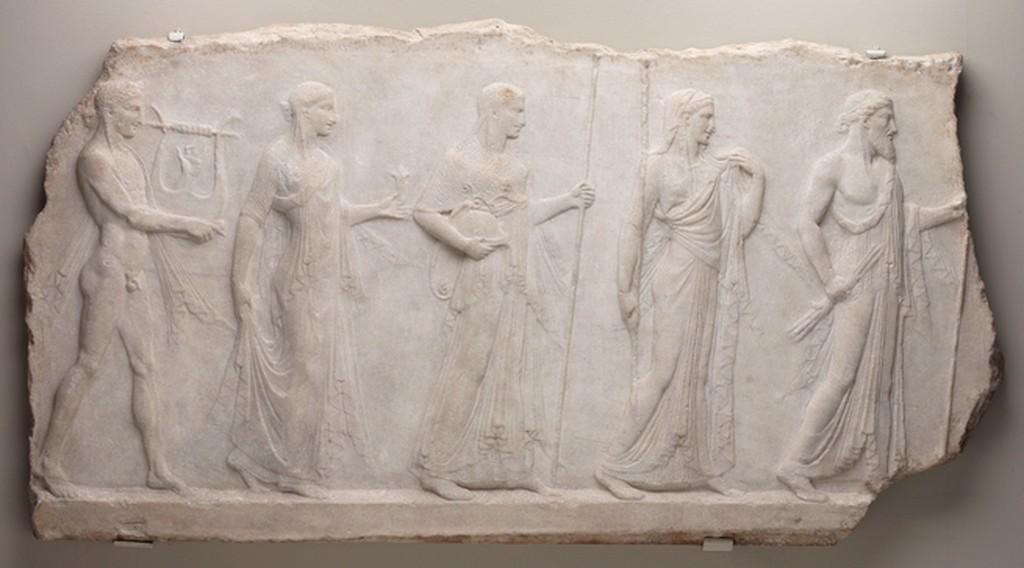 Archaistic relief showing five divinities: Zeus, Hera, Athena, Aphrodite, and Apollo.