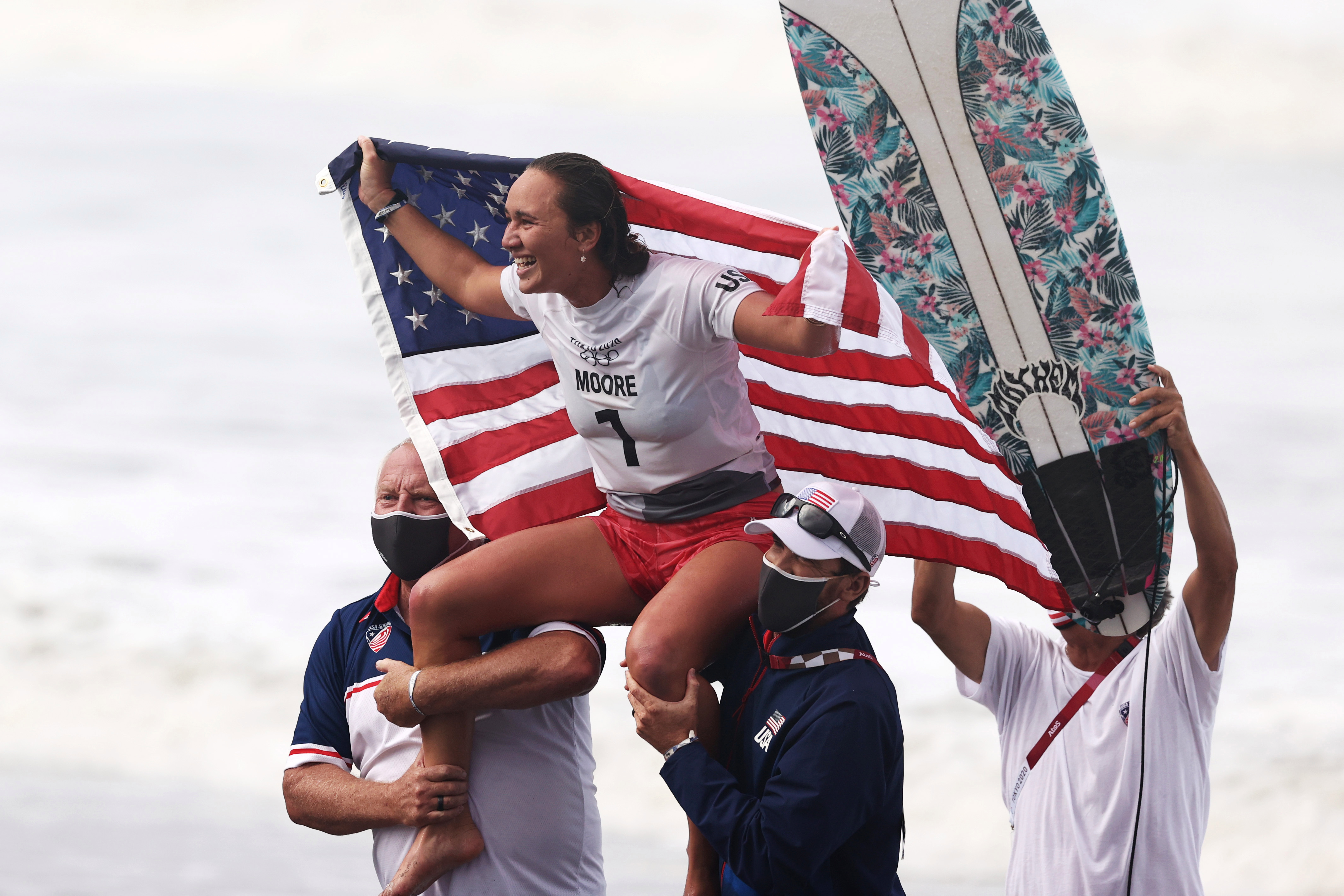 Carissa Moore holding a US Flag