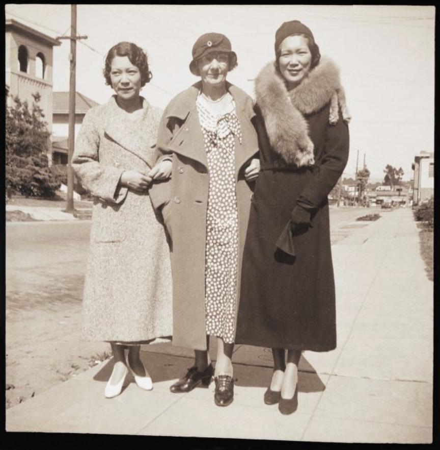 [Three women on sidewalk]
