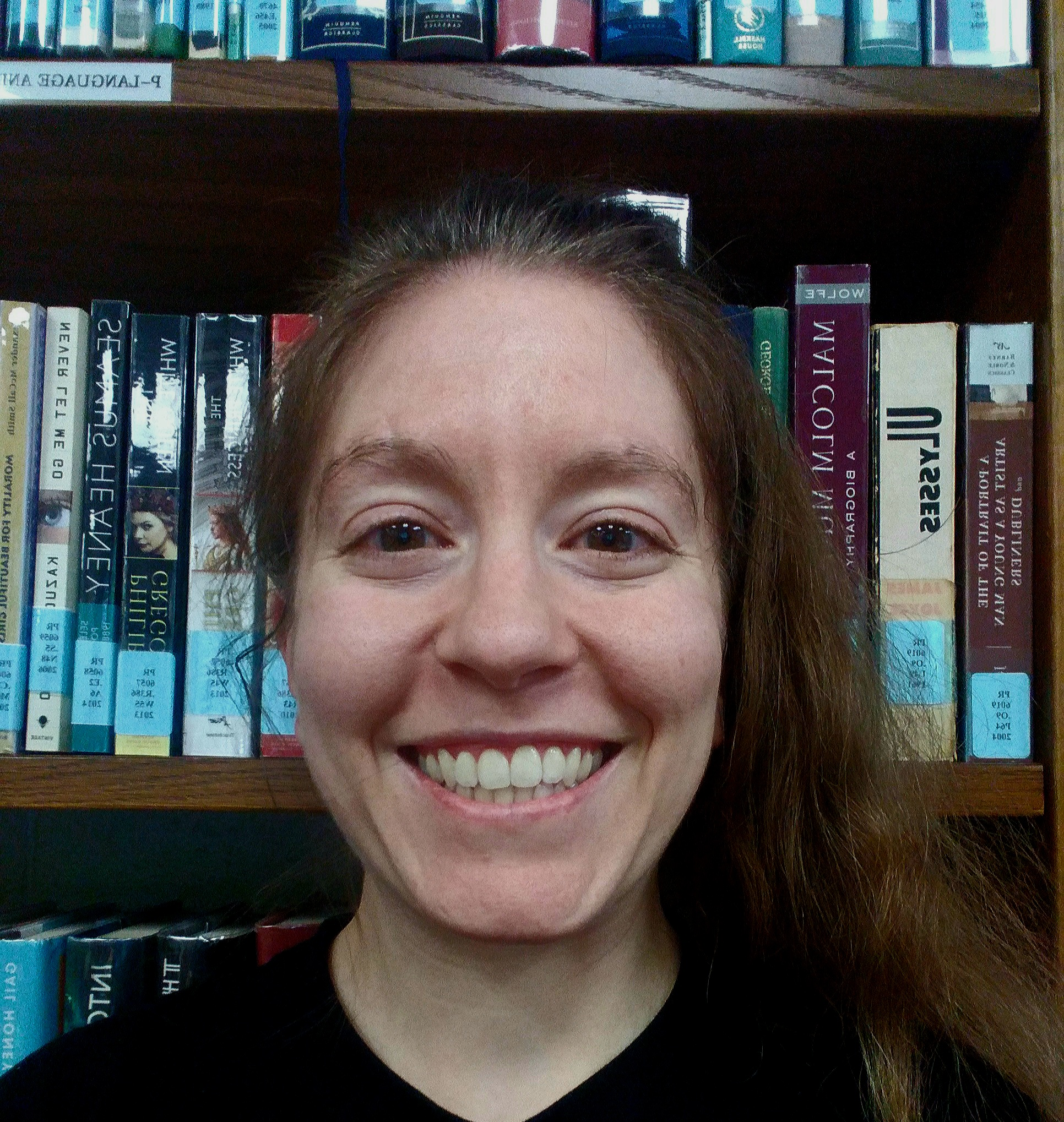 Picture of woman in front of bookshelves