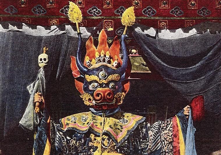 Yama, tibetan god of the dead standing in regalia