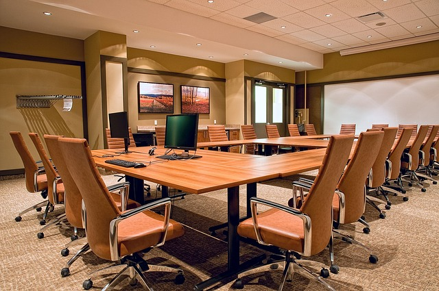 Boardroom with chairs and white board