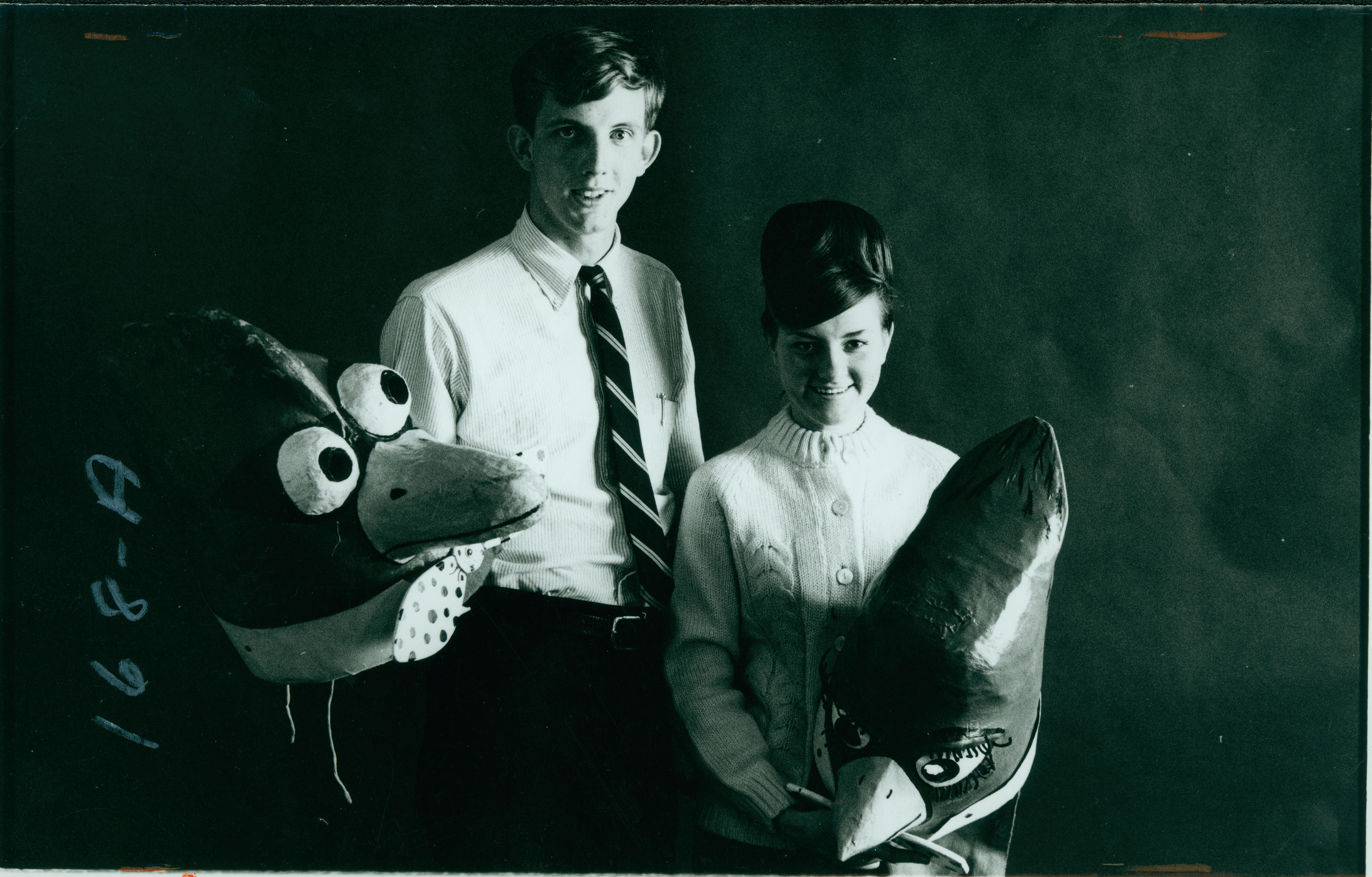 Cardinal Bird and Lady Bird with their mascot costume heads off, 1964