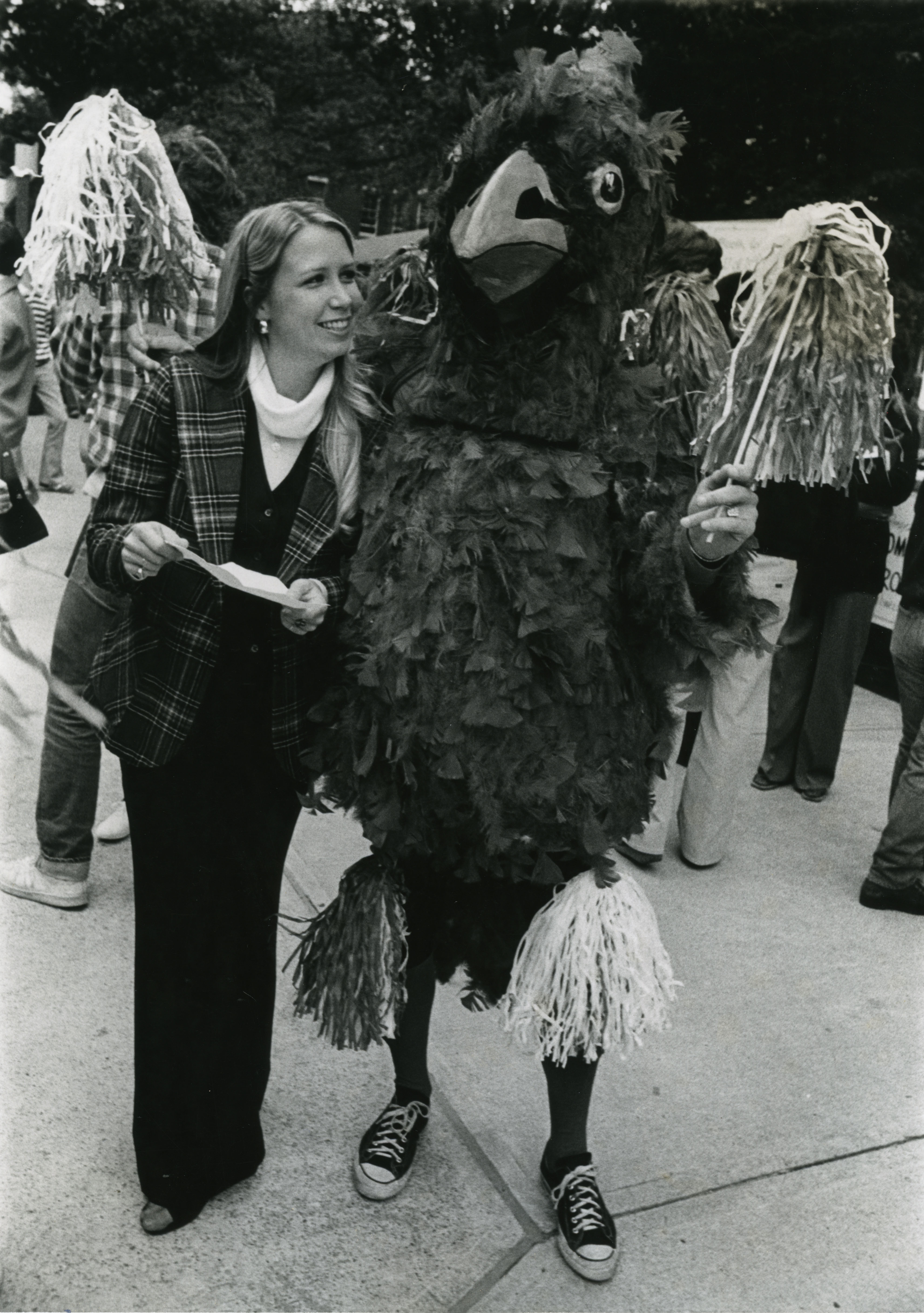 Cardinal Bird with cheerleading coach Sherrill Brakemeier at pep rally, October, 1977