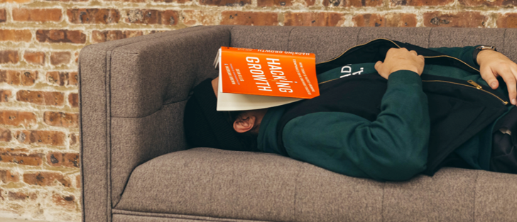 Man sleeping with book over his face