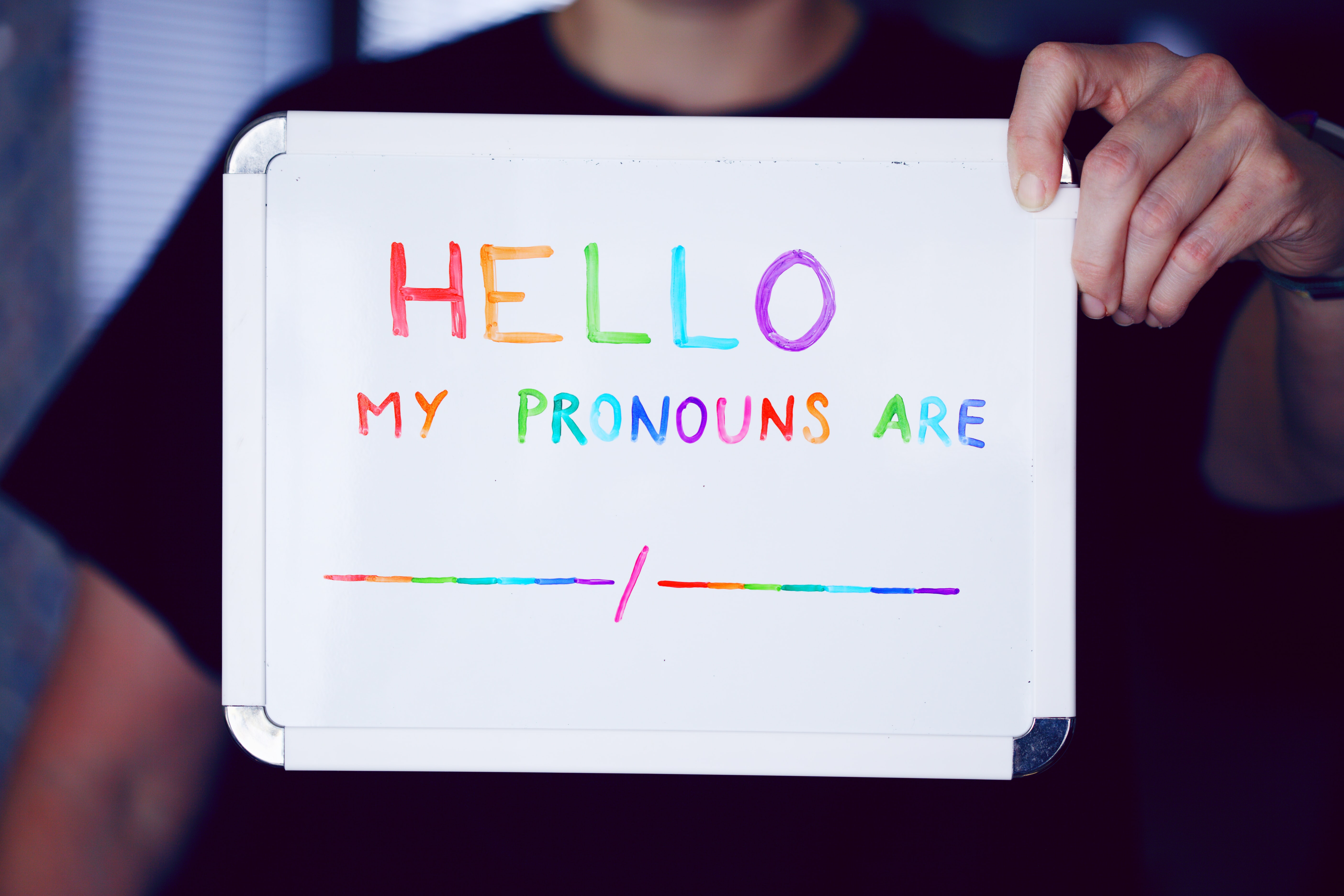 Sign that says Hello My Pronous Are...