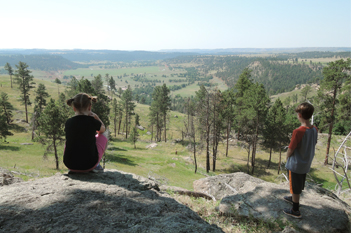 two kids looking out towards the horizon in South Dakota