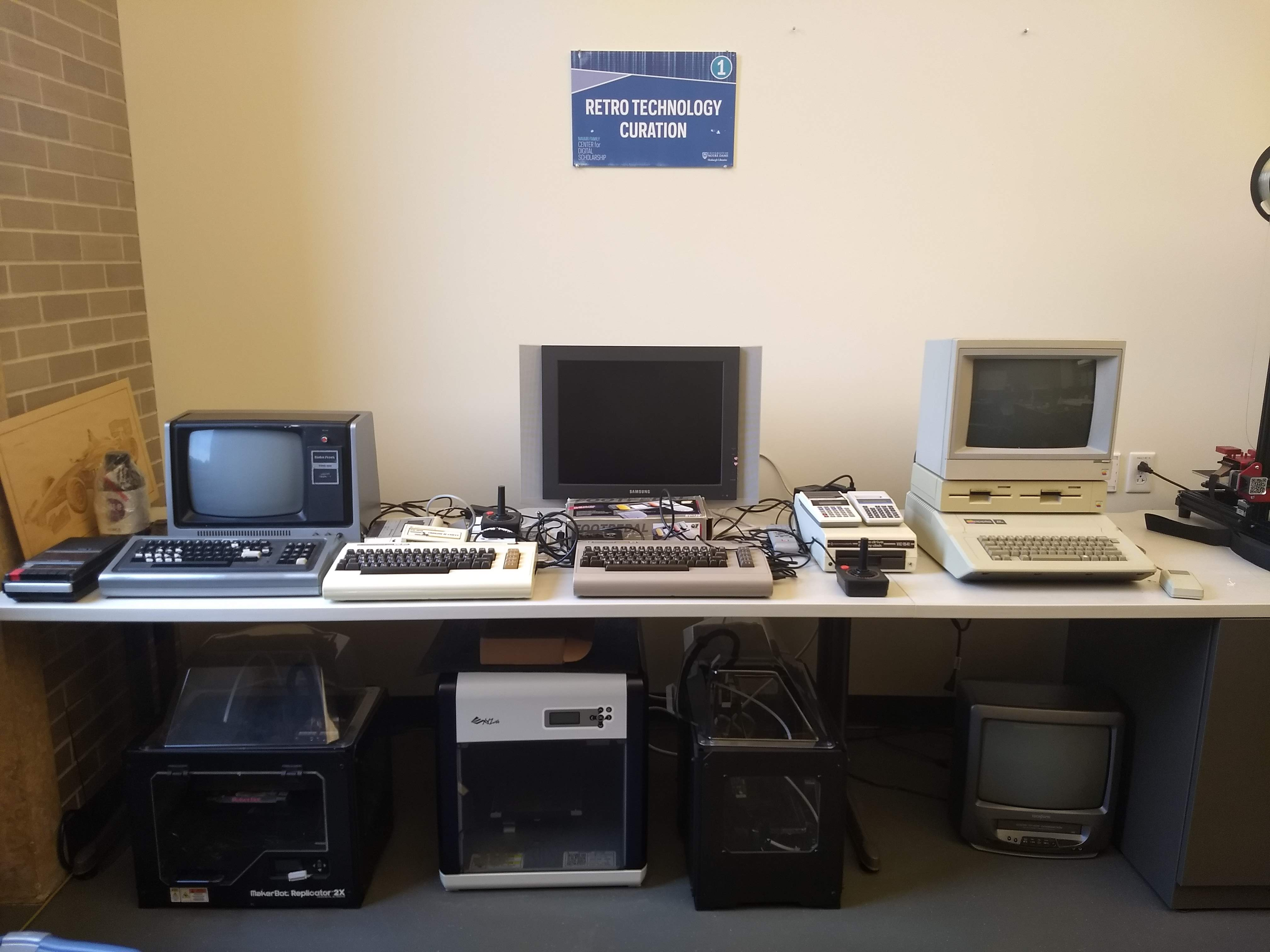 a row of old computer systems on a table