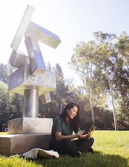Girl studying in UCLA sculpture garden