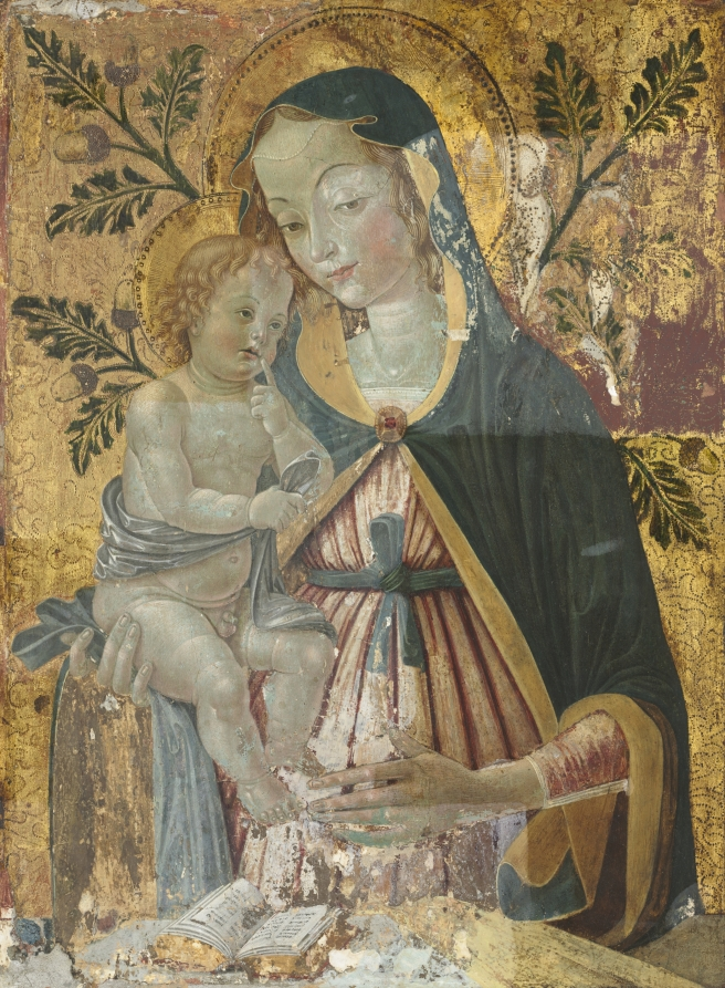 Virgin Mary holding Child Jesus with her right arm. Background is covered in gold with acorn and oak leaves painted.