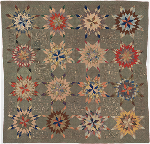Green quilt with colorful Star of Bethlehem pattern.