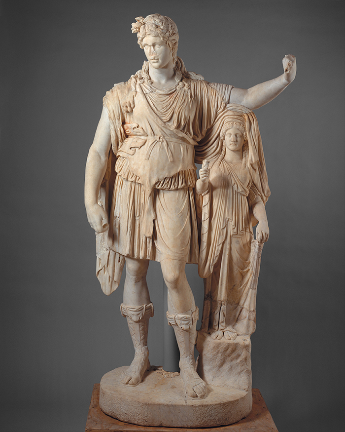 A marble statue of the god Dionysos leaning on a smaller woman figure.