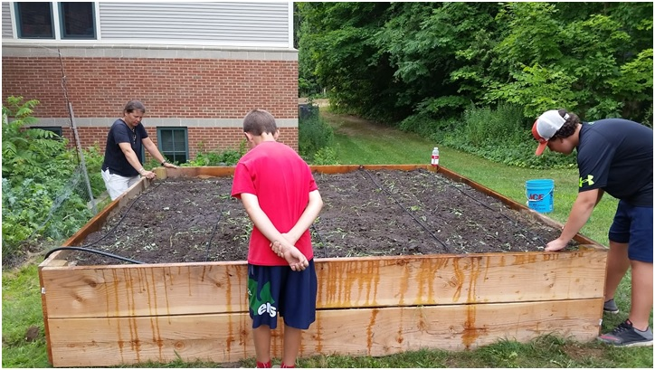 Teens build new raised garden bed for vegetables