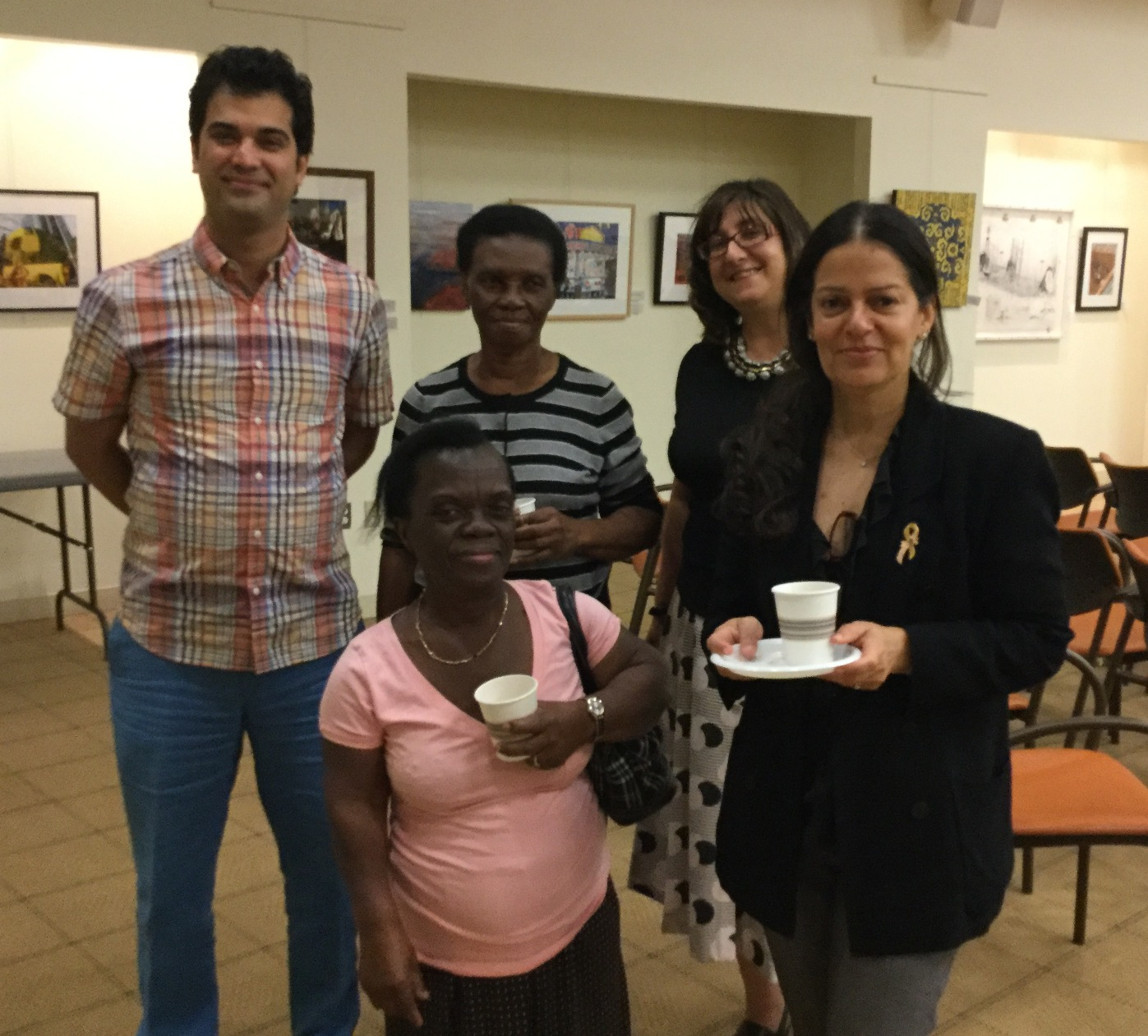 Five people celebrating end of citizenship classes