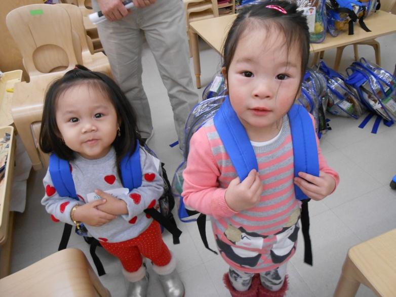 Children with backpacks full of books