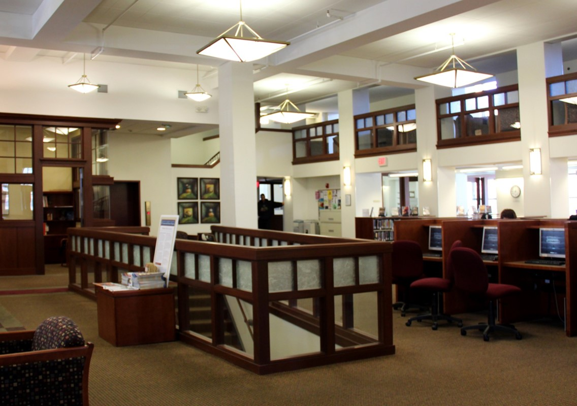 photo of the interior of the Lowell campus library, showing computer workstations