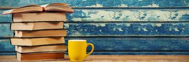 decorative image: pile of books with a yellow cup next to them
