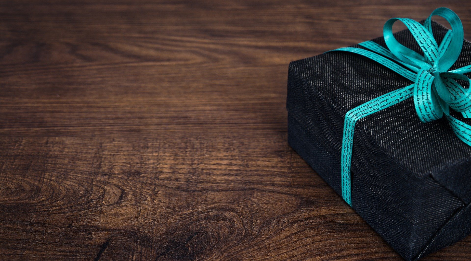 denim wrapped gift box with a teal ribbon