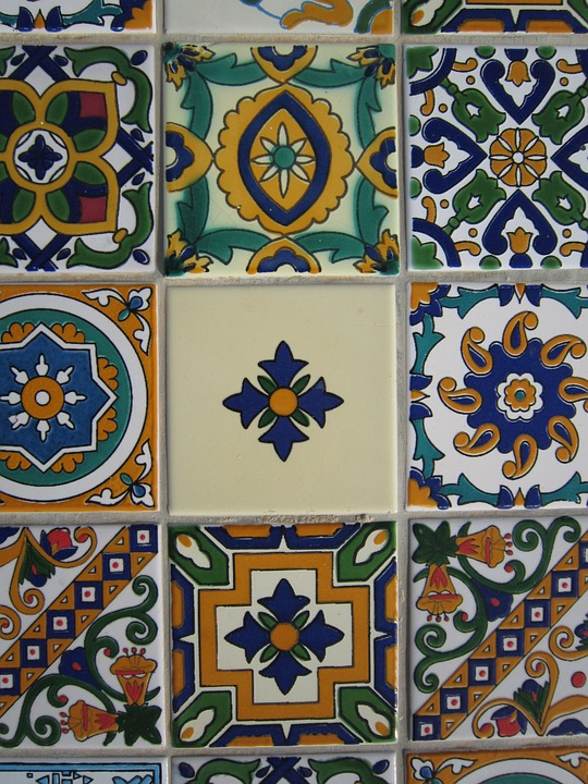 An Arabic mosaic with circular patterns.  Some of the patterns are yellow, blue, green, and red.