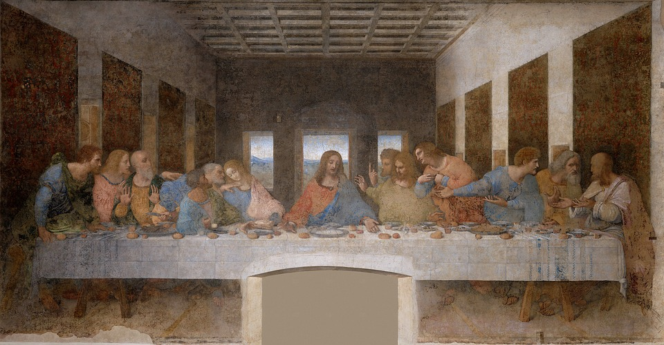 The famous Renaissance painting, The Last Supper.  Jesus is at the table with disciples talking and gesturing to each other.