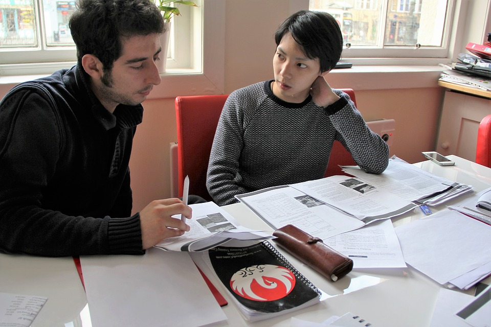 Two college students studying  at a table