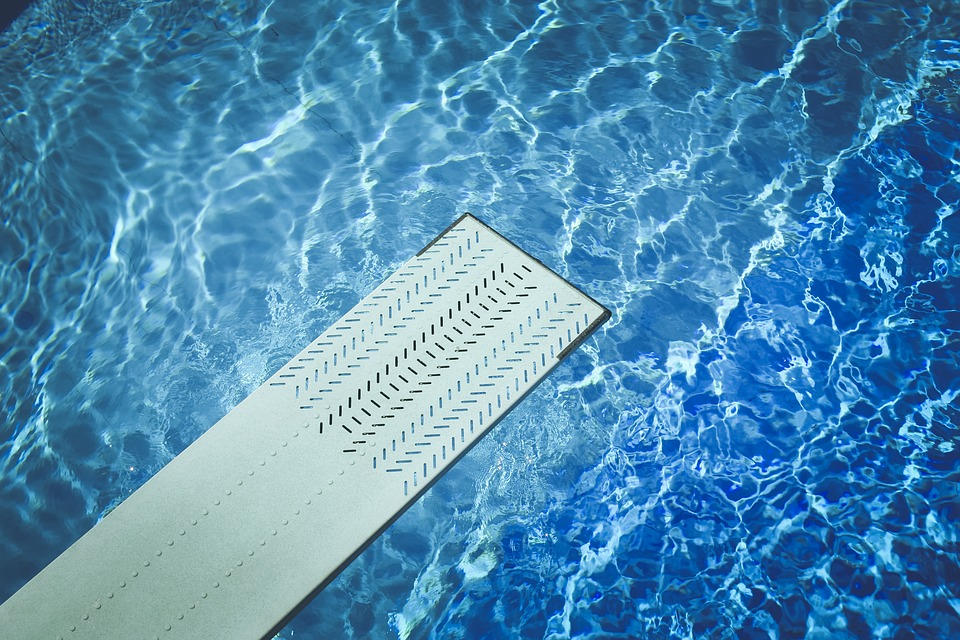 a diving board over bright blue water
