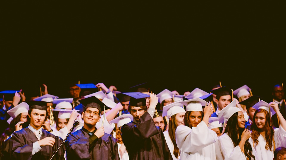 college students wearing blue, white graduation