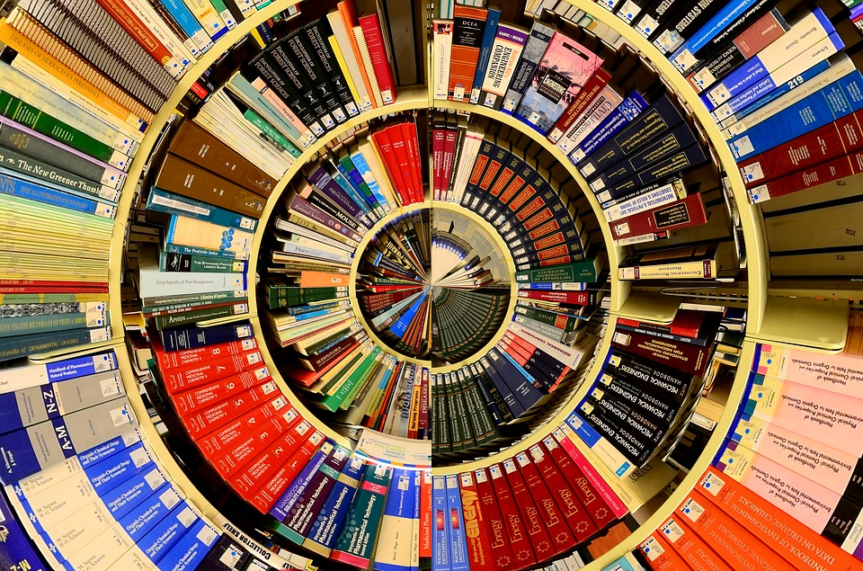 A circular images of books on a library shelf.