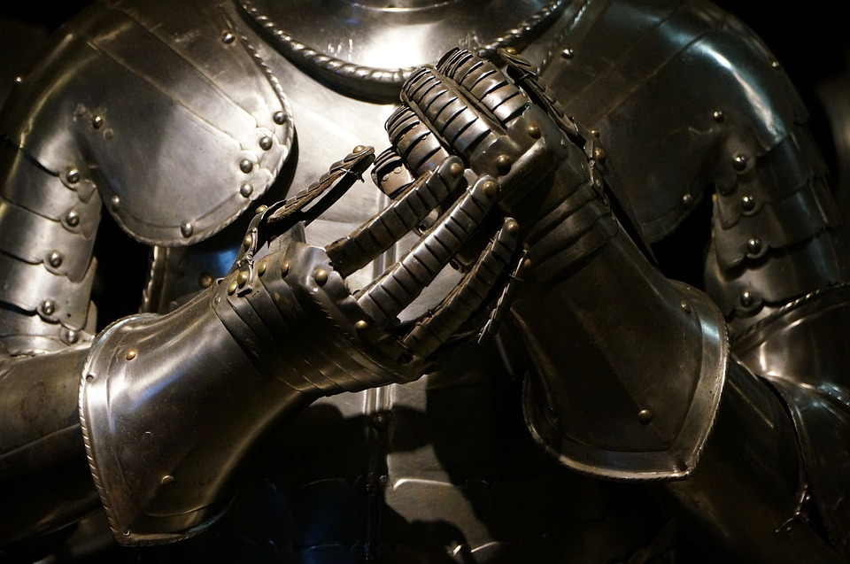 The mid-section of a knight's suit of armor.  The knight is raising their hand