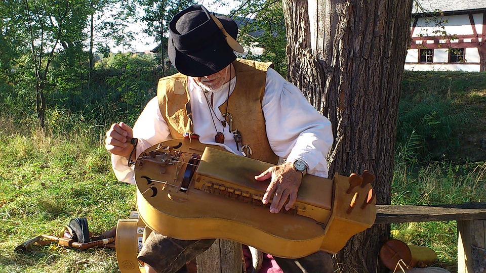 a man playing a medieval instrument