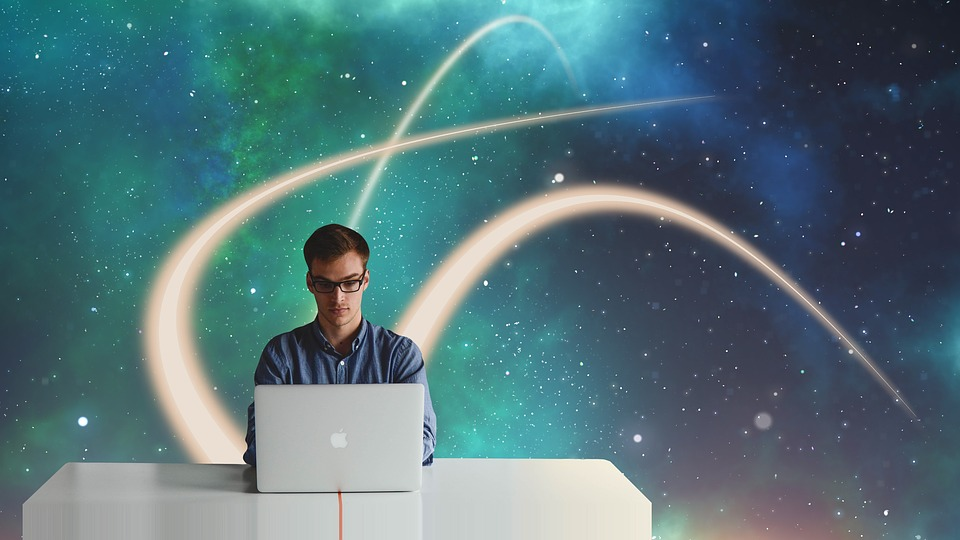 man on a couch with laptop, white streaks going into space in the background