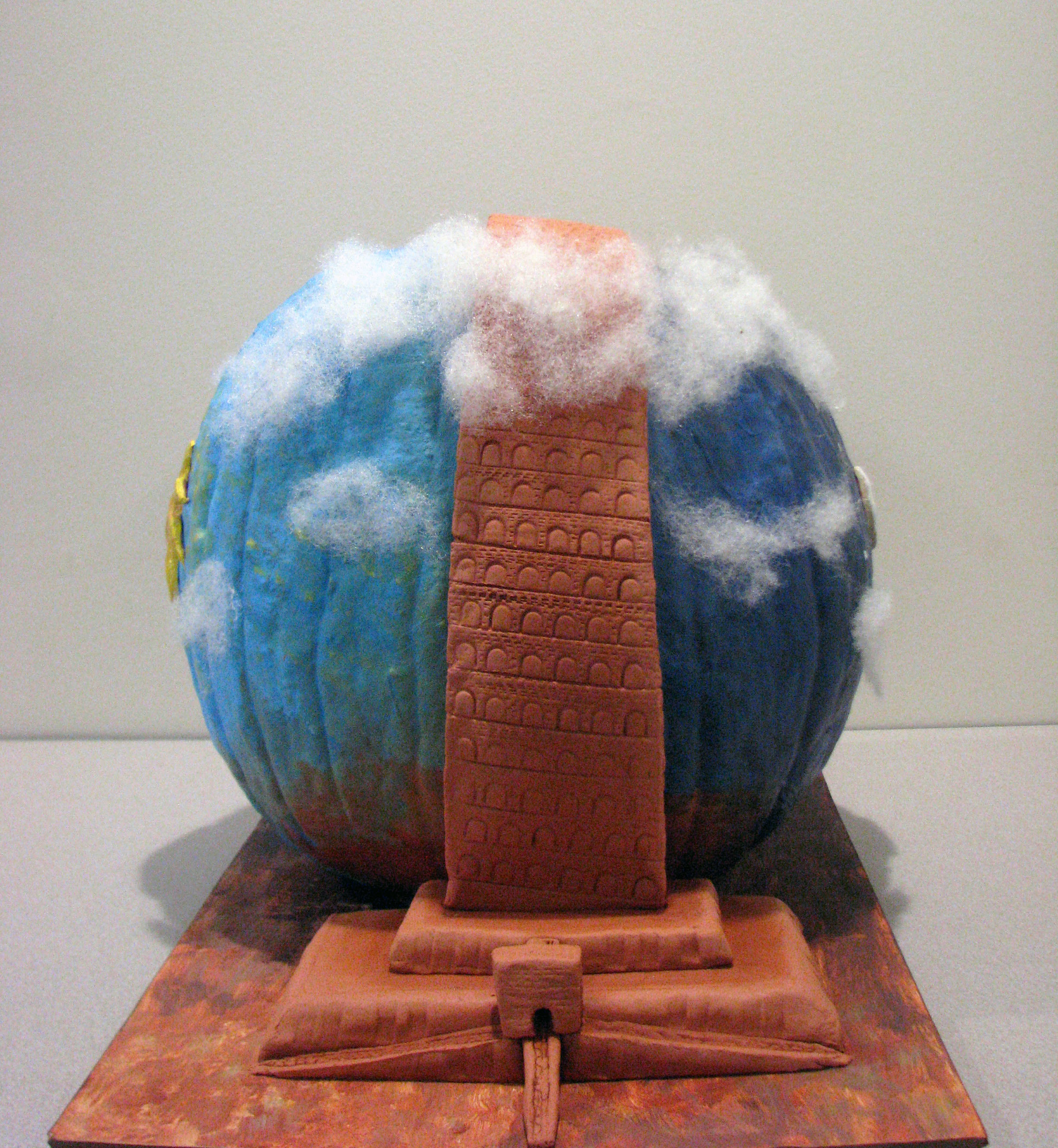 Painted pumpkin with a clay tower attached